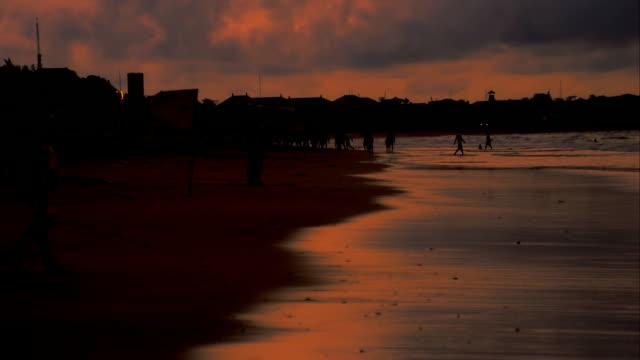 WS Tourists On The Kuta Beach At Dusk