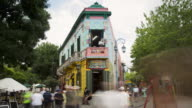 TL, MS Tourists photograph and look at Caminito in La Boca / Buenos Aires, Argentina