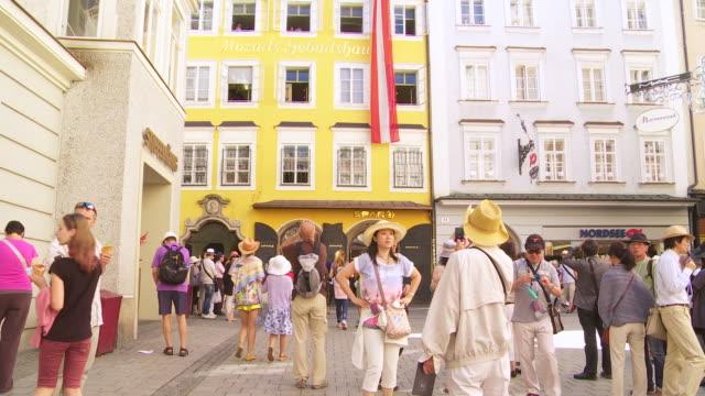 TILT UP Tourists Regarding the Birthplace of Wolfgang Amadeus Mozart in Salzburg