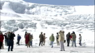 Tourists sightseeing at Athabasca Glacier, Canadian Rocky Mountain Parks, Canada
