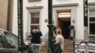 Tourists take photographs outside the iconic London music studios made famous by the Beatles