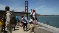 Tourists take pictures in front of the Golden Gate Bridge on April 27 2015 in San Francisco California Golden Gate Bridge officials are asking the...