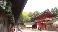 Tourists visit the Kasuga Shrine in Nara, Japan.