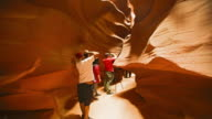 Tourists visit the Upper Antelope Slot Canyon in Page, Arizona.