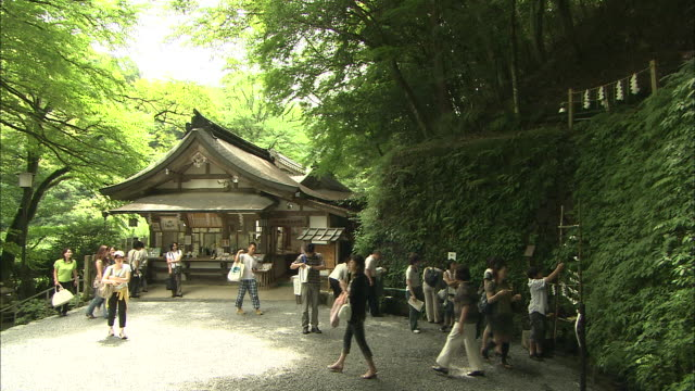 Tourists walk through a plaza at Kibune Shrine.