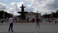 Tourists walking and taking pictures at Place de la Concorde in Paris France In the background the fountain