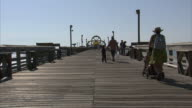 MS Tourists walking on fishing pier / Myrtle Beach, South Carolina, United States