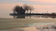 Tourists walking on pier over lake Balaton