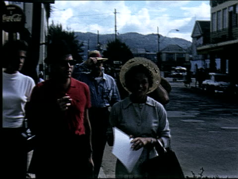 Tourists walking through town in Jamaica on January 01 1950 in Jamaica