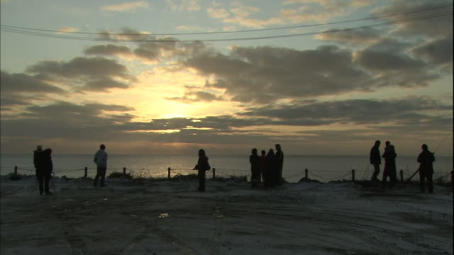 Tourists watch the First Sun of the Year rising over Cape Nosappu in Hokkaido, Japan.