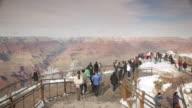 WS PAN Tourists watching Grand Canyon at Mather Point in winter / Grand Canyon National Park, Arizona, USA
