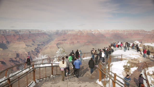 WS PAN Tourists watching Grand Canyon at Mather Point in winter / Grand Canyon National Park, Arizona, USA