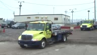 Tow Trucks Leaving Auto Pound Lot on December 12 2013 in Chicago Illinois