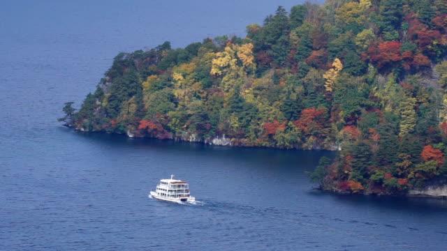 Towada lake and sight seeing boat cruising during autumn season, Akita, Japan.