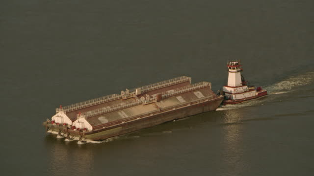 AERIAL Towboat pushing a barge on  a calm river
