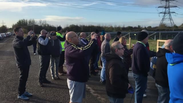 Tower at Kellingley Colliery demolished Crowd of people gathered to watch demolition of Kellingley Colliery Onlookers taking pictures and filming on...
