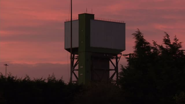 Tower at Kellingley Colliery demolished ENGLAND North Yorkshire Kellingley Colliery Tower at Kellingley Colliery at sunrise DAY Man closing gates