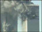 WTC towers burning / papers flutter out of building / large smoke plume and skyline / filmed from the East Village East 9th Street and 1st Ave...
