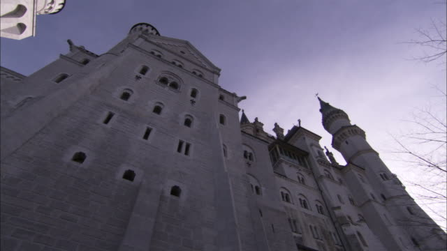Towers, turrets and arched windows decorate the exterior of Neuschwanstein Castle. Available in HD