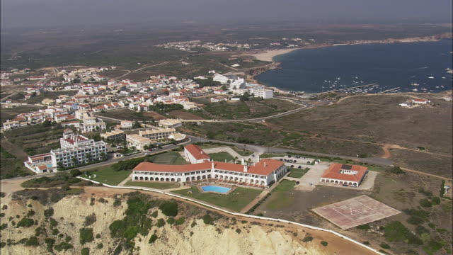 AERIAL WS Townscape with hotel on top of cliff / Sagres, Faro, Portugal