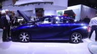 A Toyota Fuel Cell System power unit sits under the hood of a Toyota Mirai hydrogen powered automobile manufactured by Toyota Motor Corp during the...