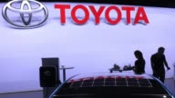 A Toyota Prius plugin hybrid vehicle sits on the Toyota Motor Corp exhibition stand during the second media preview day of the IAA Frankfurt Motor...