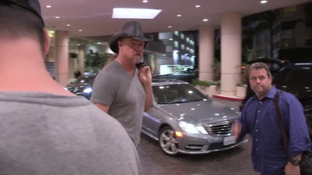 Trace Adkins greets fans while departing The Beverly Hilton Hotel in Beverly Hills 06/12/13
