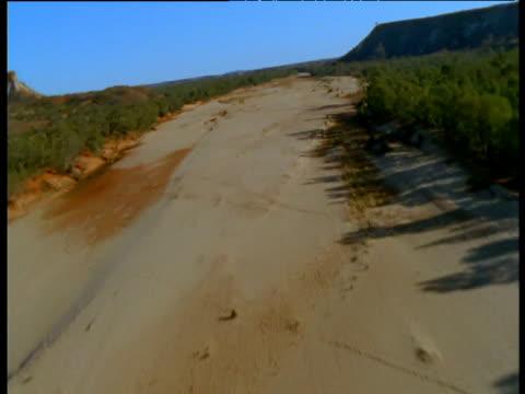 Track along dry bed of Finke River, Northern Territory, Australia
