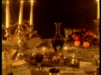 Track along reconstruction of candle-lit Victorian banquet table