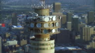 Track back from top of Hillbrow tower to reveal surrounding high rise buildings, Johannesburg Available in HD.