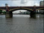 Track forward along River Thames under Vauxhall Bridge pan right to MI6 building