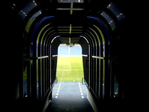 Track forward as though walking down players tunnel onto park Glasgow Rangers FC Ibrox Park Govan