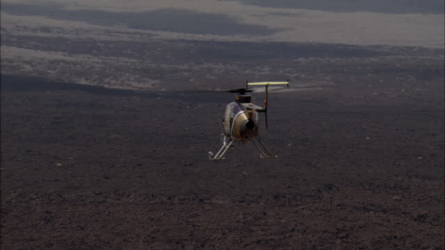 Track forward behind helicopter, Galapagos Islands Available in HD.
