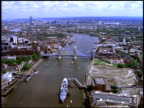 Track forward east along River Thames and towards Tower Bridge, London; 1990's