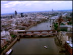 Track forward east along River Thames over Blackfriars Bridge towards Southwark Bridge, Cannon Street Bridge and London Bridge, London; 1990's