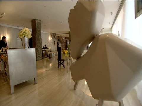 Track forward into uniquely styled lobby at Sanderson Hotel London