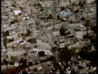 Track forward over densely packed slum areas Mexico City