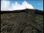 Track forward over dramatic volcanic landscape Hawaii