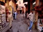 Track forward through souk past stalls