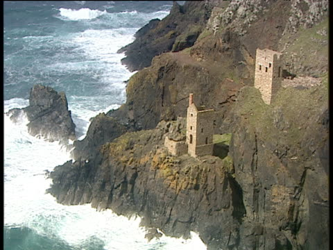 Track forward to remains of Botallack Tin Mines perched on edge of cliff Cornwall