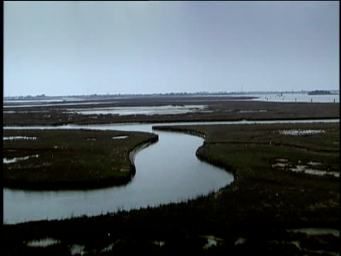 Track forwards over Venetian lagoon and marshes
