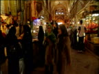 Track forwards though bustling market of Isfahan