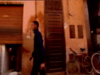 Track left along street past pedestrians and shops Marrakesh