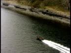 Track left alongside fast moving rigid inflatable boat on Loch Nevis Argyllshire