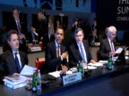 Track left past British Prime Minister Brown President Obama Chancellor Alistair Campbell and Secretary Tim Geithner seated at start of G20 Summit 2...