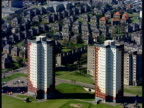 Track left past rows of colourful tower blocks Aberdeen