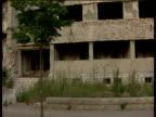 Track left past war damaged shelled out buildings Mostar; 2000