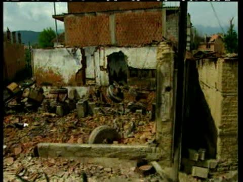 Track left through deserted and derelict Kosovan village Kosovo Situation 21 Jun 99