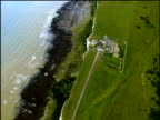 Track over Belle Tout Lighthouse with sheer drop to sea below the white cliffs Beachy Head