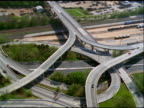 Track over freeway intersection and tilt up to helicopter, Baltimore